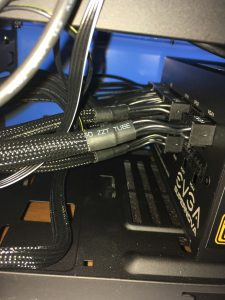 Power cables plugged into the power supply.